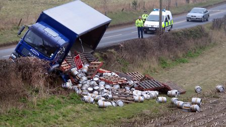 Scene on Halesworth Road Reydon at about 10.30 am today after a Adnams lorry shed its load on farml