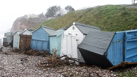 Budleigh beach huts were damaged during the storms. Photo by Terry Ife. Ref exb 1486-06-14TI To orde