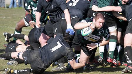 North Walsham's Mark McCall rumbles towards the try line at Scottow.