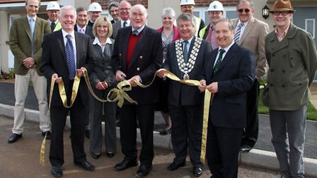 Lord Clinton cuts the ribbon to a show home at the Budleigh Green Way housing development. Picture b