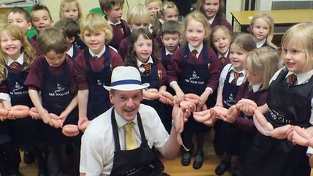 Pupils from Lady Seaward's School with Darts Farm butcher Alastair David and their Lady Seaward's Sa
