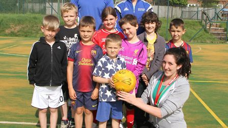 The five to eight year old's group try out the newly resurfaced courts at Exmouth's Cranford Leisure