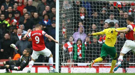 Sebastien Bassong has his shirt pulled by Olivier Giroud before putting the ball into his own net fo