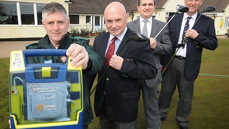 A defibrillator is handed over to Royal Cromer Golf club. Andrew Barlow, Community Partnership manag