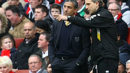 Norwich manager Chris Hughton and first team coach Paul Trollope (right) during City's defeat at Ars