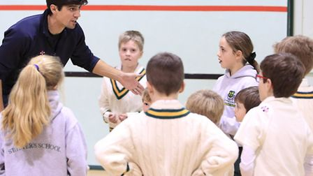 Alastair Cooke with children at St Peters school