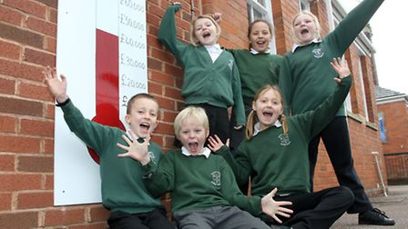 Year four children from St Peters primary school in Budleigh Salterton are pictured with their Warm