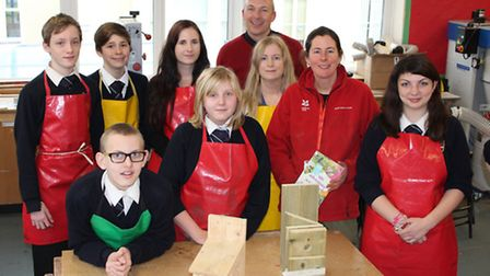 Exmouth Community College pupils, who have been making bird box kits, with Ruby Cole of the National