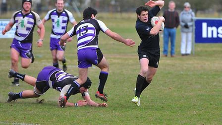Richard Justice on the ball for Holt during their 36-5 defeat against Woodford on Saturday.