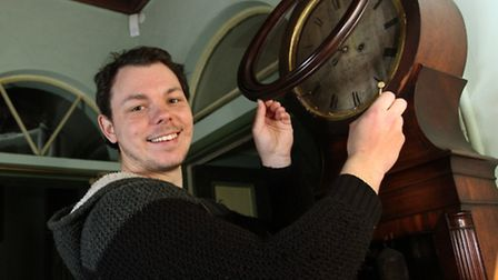 A la Ronde Assistant House Steward James Weckmueller winds a Grandfather clock dating back to around