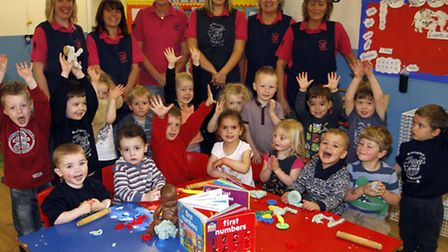Brixington pre-school staff and children celebrating their recent good Ofsted report. Ref exe 5807-1