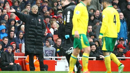 Arsene Wenger is not happy about the amount of time it's taking Bradley Johnson to leave the pitch.