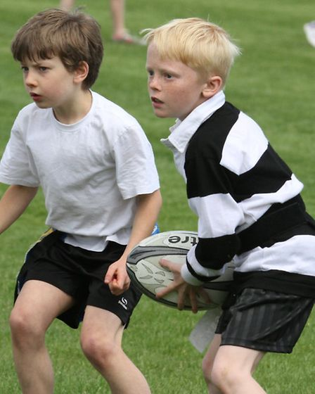 St Peters Primary School in black and white play Newton Poppleford in the school's TAG rugby tournam