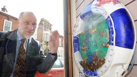 The Lovely Lifebuoy Art Trail. Owner of Bertram Watts book shop in Sheringham, Peter Hill with their