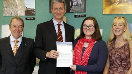 Exmouth college student Chloe Hurrell with head teacher Tony Alexander and David Marston and Jennie