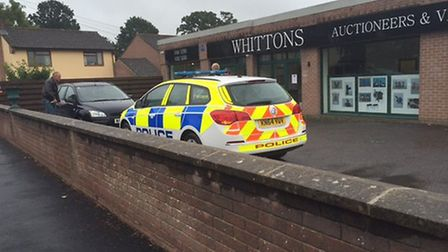 A police car outside Whittons Auctioneers