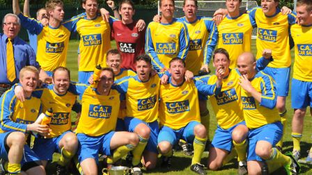 Colin Tovell (chairman), left, celebrates with the players after Acle Rangers won the Copy IT League