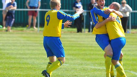Acle Rangers celebrate James Foreman's third goal. Picture: Steve Adams