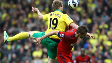 Luciano Becchio wins a header and flicks it on to start the move that leads to Norwich City's fourth