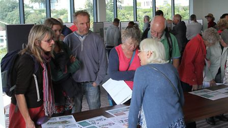 Crwods gathered to view the Rolle proposal plans at the Ocean suite on Saturday. Ref exe 2692-41-15