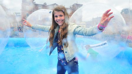Langley school Daffodil, craft and country fayre.Keira Wheeler having fun inside giant inflatable zo
