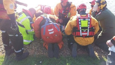 Rescue teams work to help a man who suffered serious injuries in a fall on the Broads yesterday. Pic