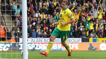 Grant Holt rolls the ball into an empty net to give Norwich City a 2-0 lead. Picture: Paul Chesterto