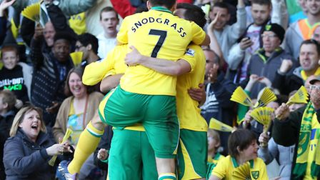 Elliott Bennett is mobbed after his match-winner sunk Reading recently. The Canaries need a Premier