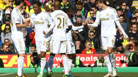 Swansea celebrate after Michu (right) scores against Norwich City last month. City fans will be reli