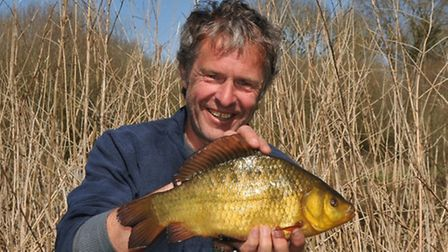 John Bailey with a perfect pond crucian.