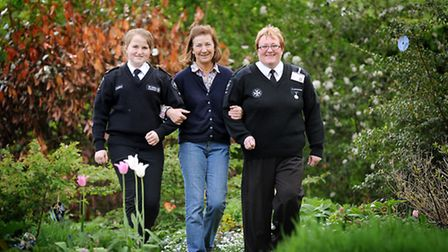 Georgina Holloway (centre) has opened her garden up to the public to raise money for the St John Amb