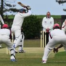 Swardeston A's Dale Reynolds bowls during the abandoned game at Lowestoft.