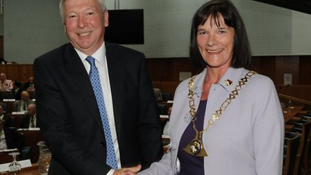 New Norfolk County Council chairman Hilary Cox is welcomed to the post by outgoing chairman Ian Mons