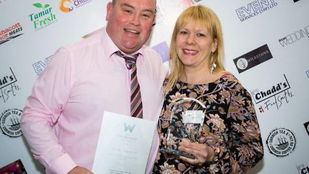 Darren and Jane England with their award.