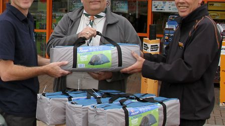 Ian Edgecumbe of 7th Exmouth scouts receiving a donation of new tents from local builder Paul Fell a