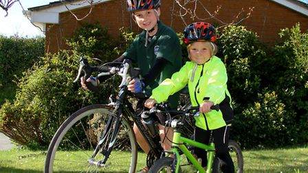 Brothers Dylan and Charlie Travers, get ready to cycle for charity, raising money for Cancer Researc
