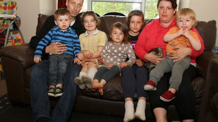 Brett Evans and his partner, Daniele Hughes and their five children in their two bedroom council fl