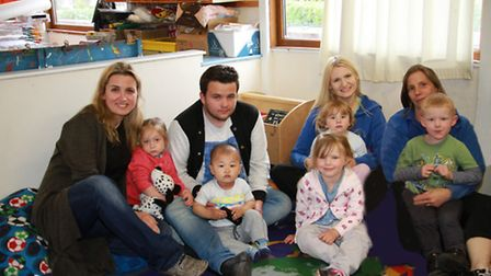 Sarka Andersonova (left) of Carousel Childcare in Budleigh with some of the children. Ref exb 20-16T