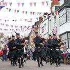The newly formed Exmouth and District Pipe Band lead the procession at the Bicton Street Party for t