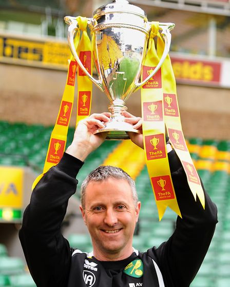 Norwich City Under-18s manager Neil Adams with the FA Youth Cup. Picture: Denise Bradley