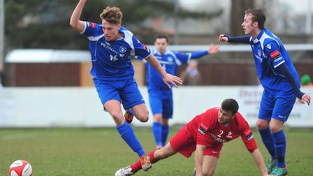 Josh Dawkin (far right) in Ryman League Premier Division action for Lowestoft Town and Carshalton At
