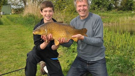 John Bailey and Jack hold a gorgeous common carp picked up on the surface.