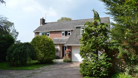 A spacious detached four bedroom family house set within large level landscaped private gardens adjo