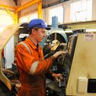 An apprentice at work in the milling and boring department at AKD Engineering. Picture: James Bass