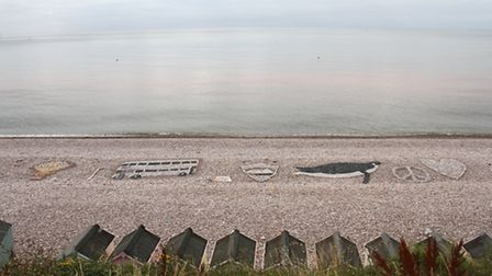 Pebble art on Budleigh Salterton beach before it was damaged. Ref exb 30-16SH 3036. Picture: Simon H