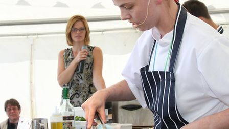 Kathy Evans from The Chronicle preparing a dish at last year's Exmouth Mussel Festival. Ref exe 0099