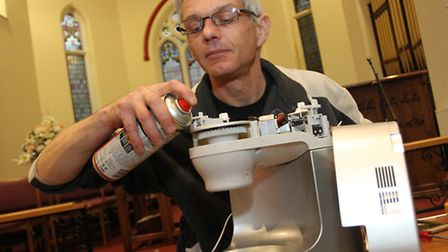 Nick Worsfold works on repairing a food mixer at the Repair Cafe held in the Tower Street Methodist