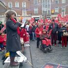 Devon County Councillor Claire Wright addresses crowd at rally against hospital bed cuts