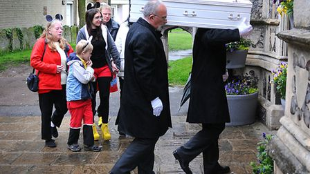 Family, including mum Hayley, dad Darren and brother Keenan, nine, follow Ryan Wright's coffin into