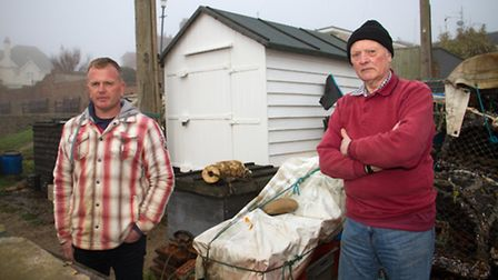 Roger and Samuel Pym outside their shed on Budleigh Beach. Ref exb 04-17TI 6064. Picture: Terry Ife